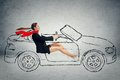 Side profile attractive woman driving car happy smiling business isolated on grey wall background Royalty Free Stock Photography