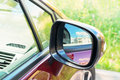 Side rear-view mirror on car Royalty Free Stock Photo