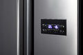 Side by side refrigerator detail of steel Royalty Free Stock Photo