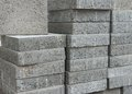 Side of a stockpile of flat gray square pavement bricks Stock Photography