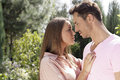 Side view of affectionate young couple looking at each other in park Royalty Free Stock Photo