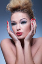 Side view of an amazed beauty woman with nice makeup and red nails Stock Image