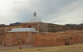 Side view ancient tumacacori mission showing adobe buildings white dome against dramatic cloudy sky Royalty Free Stock Photos