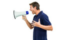 Side view of angry man shouting through megaphone against white background Royalty Free Stock Image