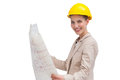 Side view of architect holding construction plan and wearing yellow helmet Royalty Free Stock Photos