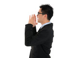 Side view asian business man shouting young with hands cupped to his mouth isolated on white background Royalty Free Stock Photos