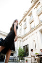 Side view attractive elegant businesswoman walking to business meeting luxury coffee shop terrace Stock Photography