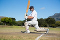 Side view of batsman on field Royalty Free Stock Photo