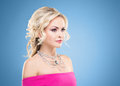 Side view of beautiful blond in pink dress wearing necklace with Royalty Free Stock Photo