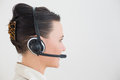 Side view of a beautiful businesswoman using headset close up over white background Royalty Free Stock Photos