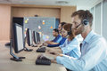Side view of business people working at call center Royalty Free Stock Photo
