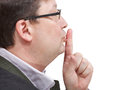 Side view of businessman's finger near lips Royalty Free Stock Photo