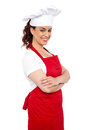 Side view of cheerful chef posing casually Royalty Free Stock Photos