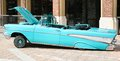 Side view of chevrolet bel air low rider s lite blue chevy with hydraulics Stock Photo