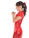 Side view chinese cheongsam girl greeting asian woman with traditional dress or qipao respecting on new year festival female model Royalty Free Stock Photos