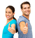 Side view of couple showing thumbs up gesture portrait happy while standing back to back over white background horizontal shot Stock Photography