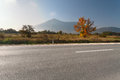 Side view of empty asphalt road in mountain area Royalty Free Stock Photo