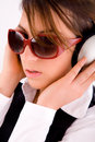 Side view of fashionable woman listening to music Stock Images