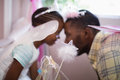 Side view of father and daughter playing while wearing fairy costume Royalty Free Stock Photo