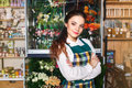 Side view of a florist small business owner checking her fresh flovers Royalty Free Stock Photo
