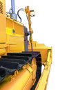 Side view of the front of the bulldozer closeup isolated on white background Royalty Free Stock Photo