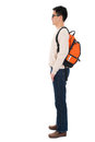 Side view full body asian adult student in casual wear with school bag standing isolated on white background male model Royalty Free Stock Images