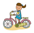 Side view of girl is riding a bike Royalty Free Stock Images