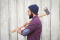 Side view of hipster with axe Royalty Free Stock Photo