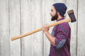 Side view of hipster with axe on shoulder Royalty Free Stock Photo