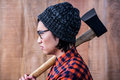 Side view of hipster holding a axe Royalty Free Stock Photo
