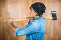 Side view of hipster standing with axe Royalty Free Stock Photo