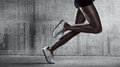 Side view of a jogger legs on concrete wall sports background runner Stock Photography