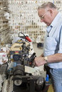 Side view of locksmith working in key store Stock Photos