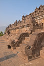 Side View of main stairs at Borobudur at the base with plenty of small stupas andbuddha statues Royalty Free Stock Photo