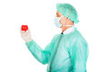 Side view of male doctor holding heart model Stock Image