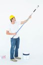 Side view of man painting on white background Royalty Free Stock Photo