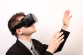Side view of a man wearing a vr virtual reality oculus rift d headset touching something with his hands exploring looking to the Royalty Free Stock Photos