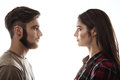 Side view. Man and woman facing each other, eyes open. Royalty Free Stock Photo
