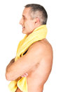 Side view mature man holding towel around neck Royalty Free Stock Images