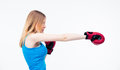 Side view portrait of a young woman in boxing gloves training isolated on white background looking away Royalty Free Stock Photo
