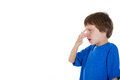 Side view profile portrait of kid pinching and holding nose because something stinks closeup isolated on white background with Stock Photo
