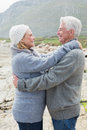 Side view of a romantic senior couple together on rocky landscape Royalty Free Stock Image