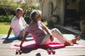 Side view of senior couple exercising together at porch Royalty Free Stock Photo