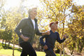 Side View Of Senior Couple Power Walking Through Park Royalty Free Stock Photo