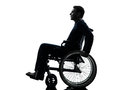 Side view serious handicapped man in wheelchair silhouette one studio on white background Royalty Free Stock Photography