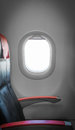 Side view single empty seat passenger airplane comfortable leather black seat red armrests window sunlight aside interior plane Royalty Free Stock Photo