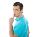 Side view of smart handsome guy gesturing silence Royalty Free Stock Image