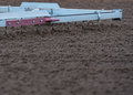 Side view of track harrow running along dirt Royalty Free Stock Images