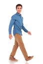 Side view of a walking smiling casual man Royalty Free Stock Photo