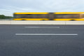 Side view on yellow city bus in motion blur Royalty Free Stock Photo